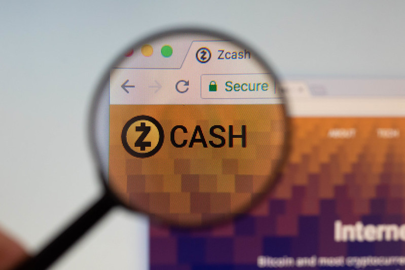 Zcash logo on a computer screen with a magnifying glass