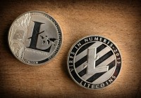 Close-up-photo-shiny-silver-litecoins-laying-on-wooden-background.-Isolated-litecoin-ltc.-Detail-Macro-photo-of-new-modern-decentralized-cryptocurrency